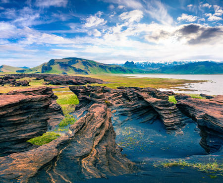 Impressive icelandic landscape on the south coast of Iceland. Colorful summer morning with volcanic ground. Beauty of nature concept background.
