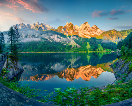 Impressive summer morning on the Vorderer Gosausee lake. Colorful sunrise in Austrian Alps, Salzkammergut resort area in the Gosau Valley in Upper Austria, Europe. Beauty of nature concept background.
