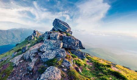 Misty summer view of Mountain range. Splendid outdoors scene in the Carpathian mountains, Ukraine, Europe. Beauty of nature concept background.