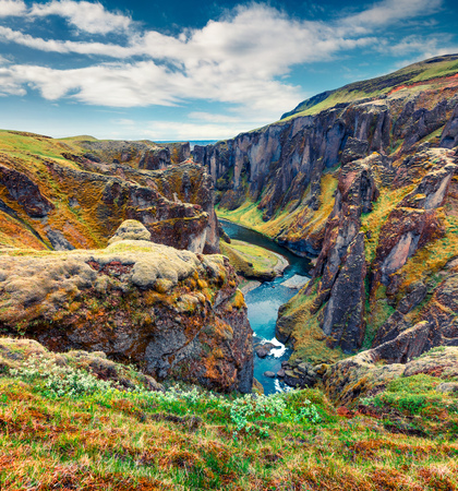 Majestic morning view of Fjadrargljufur canyon and river. Colorful summer scene of South east Iceland, Europe. Beauty of nature concept background.
