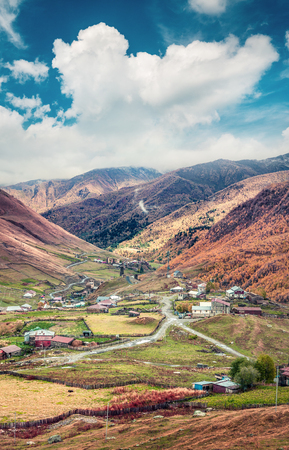 View from a birds eye of Ushguli village in the morning mist. Amazing autumn morning in the Caucasus mountains, Upper Svaneti, Georgia, Europe.
