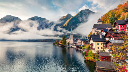Goggy autumn scene of Hallstatt lake. Splendid morning viev of Hallstatt village, in Austria's mountainous Salzkammergut region, Austria. Beauty of countryside concept background.