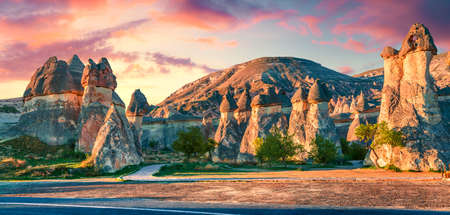 Impressive fungous forms of sandstone in the canyon near Cavusin village, Cappadocia, Nevsehir Province in the Central Anatolia Region of Turkey, Asia. Beauty of nature concept background. Imagens