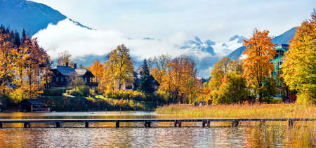 Colorful autumn panorama of Altausseer See lake. Sunny morning view of Altaussee village, district of Liezen in Styria, Austria. Beauty of countryside concept background.