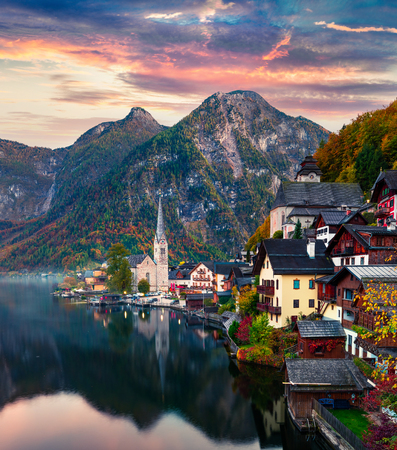 Dramatic autumn sunset on Hallstatt lake. Impressive evening viev of Hallstatt village, in Austrias mountainous Salzkammergut region, Austria. Beauty of countryside concept background.