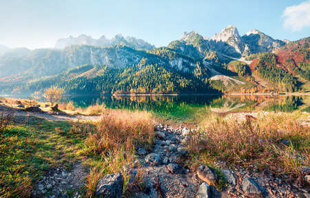 Bright autumn scene of Vorderer ( Gosausee ) lake. Picturesque morning view of Austrian Alps, Upper Austria, Europe. Beauty of nature concept background. Stock Photo