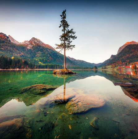 Dramatic autumn sunrise of Hintersee lake. Colorful morning view of Bavarian Alps on the Austrian border, Germany, Europe. Beauty of nature concept background. 写真素材