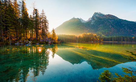 Wonderful autumn sunrise of Hintersee lake. Amazing morning view of Bavarian Alps on the Austrian border, Germany, Europe. Beauty of nature concept background. Stok Fotoğraf - 116551637