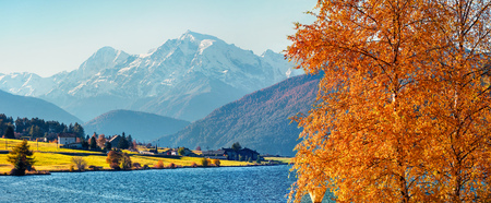 Impressive autumn scene of Haidersee (Lago della Muta) lake with Ortler peak on background. Splendid morning view of Italian Alps, Italy, Europe. Beauty of countryside concept background. Reklamní fotografie