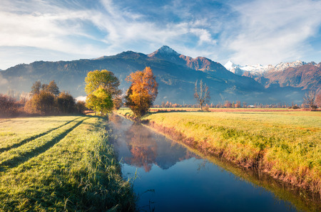 Sunny morning scene near Zell lake. Picturesque autumn view of Austrian Alps, with Grossglockner peak on background. Beauty of nature concept background.