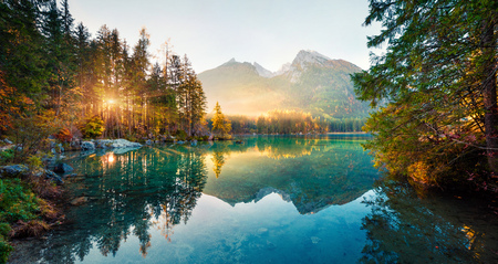 Amazing autumn sunrise of Hintersee lake. Picturesque morning view of Bavarian Alps on the Austrian border, Germany, Europe. Beauty of nature concept background. 写真素材