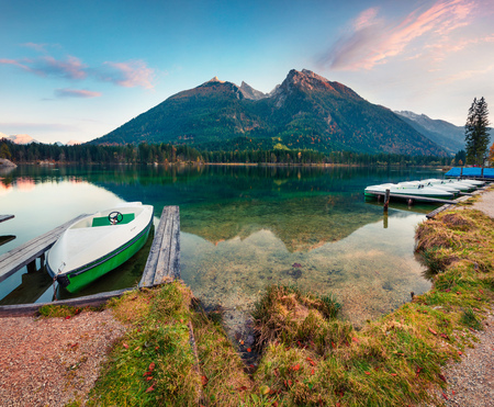 Beautiful autumn sunset of Hintersee lake. Colorful evening view of  in the Bavarian Alps on the Austrian border, Germany, Europe. Traveling concept background.
