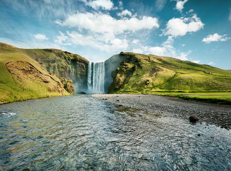 Gorgeous summer view of Skogafoss Waterfall on Skoga river. Great summer scene of Iceland, Europe. Beauty of nature concept background.