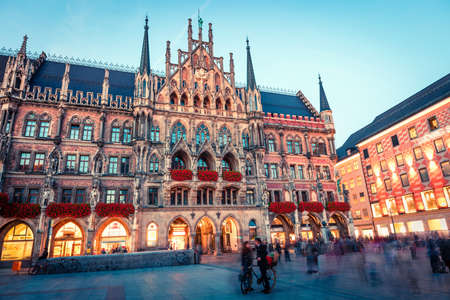 Great evening view of Marienplatz - City-center square & transport hub with towering St. Peter's church, two town halls and a toy museum, Munich, Bavaria, Germany, Europe. 写真素材
