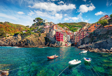 First city of the Cique Terre sequence of hill cities - Riomaggiore. Colorful morning view of Liguria, Italy, Europe. Great spring seascape of Mediterranean sea. Traveling concept background.