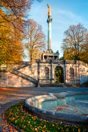 Picturesque autumn view of Angel of Peace (Friedensengel) monument, park statue of a golden angel on a column is a monument to peace with mosaics and a viewing deck, Munich, Bavaria, Germany, Europe.