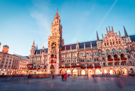 Fantastic evening view of Marienplatz - City-center square & transport hub with towering St. Peters church, two town halls and a toy museum, Munich, Bavaria, Germany, Europe.