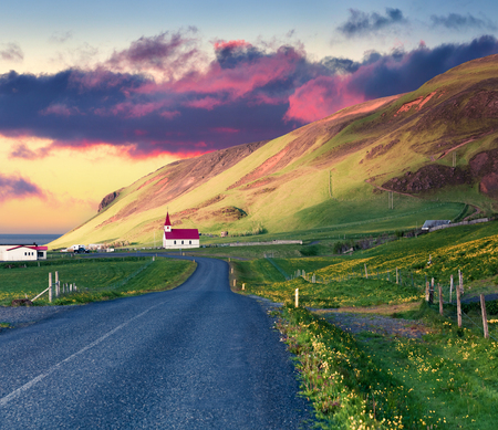 Dramatic summer sunset with Reyniskirkja church, Vik village location. Colorful outdoor scene in the south coast of Iceland, Europe. Traveling concept background.