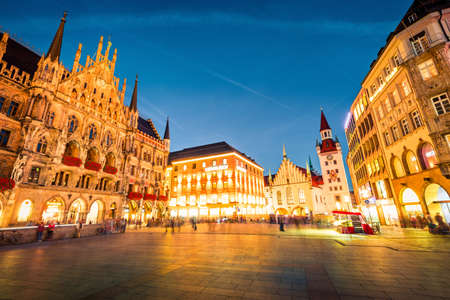 Gorgeous evening view of Marienplatz - City-center square & transport hub with towering St. Peters church, two town halls and a toy museum, Munich, Bavaria, Germany, Europe.