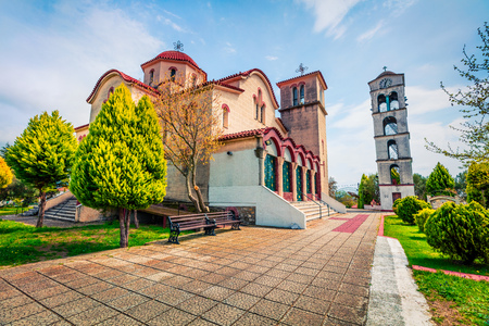 Small Orthodox Church in Nea Kerdilia village. Colorful spring scene in northern Greece. Splendid morning view ofcountryside, Kavala region. Traveling concept background.