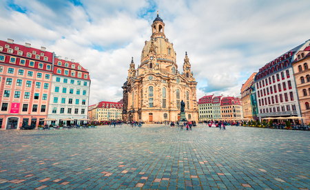 Gorgeous morning view of Baroque church - Frauenkirche, reconsecrated in 2005 after being destroyed in World War II. Picturesque autumn cityscape of Dresden, Saxony, Germany, Europe.