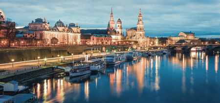 Great evennig panorama of Cathedral of the Holy Trinity or Hofkirche, Bruehls Terrace or The Balcony of Europe. Beautiful autumn sunset on Elbe river in Dresden, Saxony, Germany, Europe.