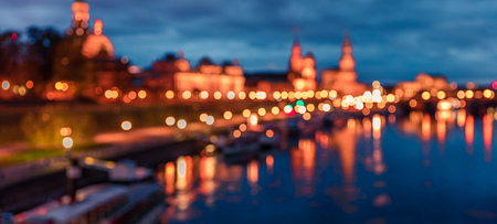 Unfocused picture of evennig of Dresden and Elbe river used us background. Colorful urbane scene.