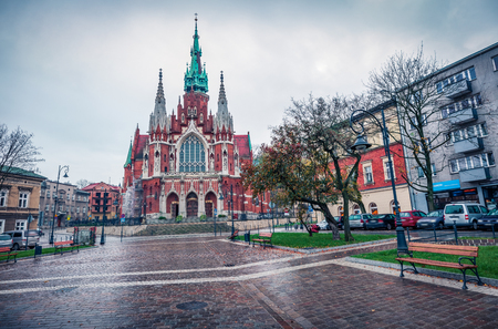 Dramatic autumn view of Parish of St. Joseph church. Rainy morning cityscape of Krakow, Poland, Europe. Traveling concept background. 스톡 콘텐츠