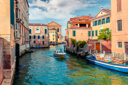 Bright spring view of Vennice with famous water canal and colorful houses. Splendid morning scene in Italy, Europe. Magnificent Mediterranean cityscape. Traveling concept background.