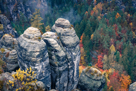 Exotic autumn view of sandstone rock. Great morning scene of Saxon Switzerland National Park, Germany, Europe. Beauty of nature concept background.