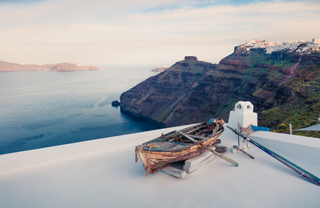 Bright morning view of Santorini island. Picturesque spring scene of the  famous Greek resort - Fira, Greece, Europe. Traveling concept background.