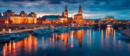 Fantastic evennig panorama of Cathedral of the Holy Trinity or Hofkirche, Bruehls Terrace or The Balcony of Europe. Dramatic autumn sunset on Elbe river in Dresden, Saxony, Germany, Europe. Stock Photo