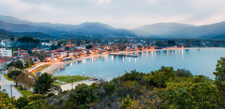 Misty spring scene of the Aegean sea. Colorful sunset of the Olimpiada town, Greece, Europe. Traveling concept background. Traveling concept background.