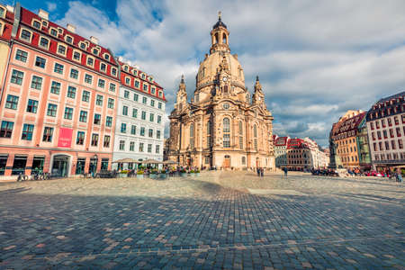 Bright morning view of Baroque church - Frauenkirche, reconsecrated in 2005 after being destroyed in World War II. Picturesque autumn cityscape of Dresden, Saxony, Germany, Europe.