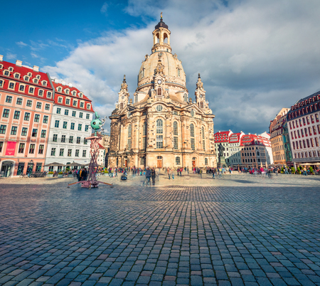 Incredible morning view of Baroque church - Frauenkirche, reconsecrated in 2005 after being destroyed in World War II. Picturesque autumn cityscape of Dresden, Saxony, Germany, Europe.
