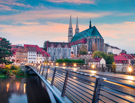 Magnificent sunrise view of St Peter and Paul's Church, on the Polish border. Colorful autumn cityscape of Gorlitz, eastern Germany, Europe. Traveling concept background.