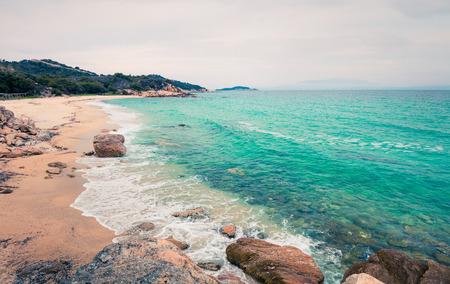 Misty summer seascape of Aegean Sea. Beautiful marine landscape of Cuba Beach, Olimpiada village location, Greece, Europe. Beauty of nature concept background. Instagram filter toned. Reklamní fotografie