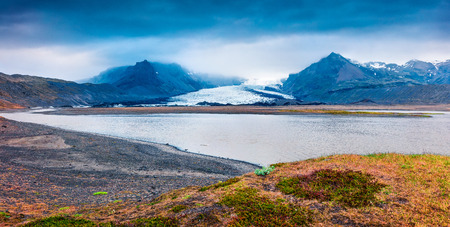 Melting ice from Vatnajokull glacier. Panoramic summer view of Vatnajokull National Park, Iceland, Europe. Beauty of nature concept background.