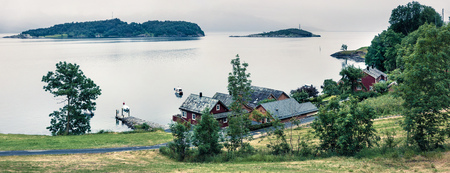Typical countryside Norwegian landscape. Misty summer panorama of Norway, Europe. Beauty of countryside concept background.