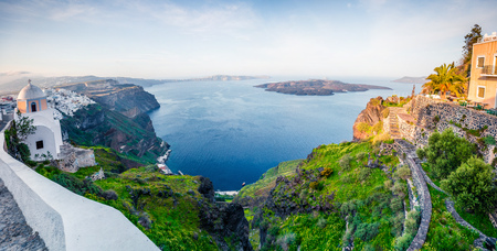 Stunning morning panorama of Santorini island. Great spring view of the famous Greek resort Fira, Greece, Europe. Traveling concept background. Artistic style post processed photo.