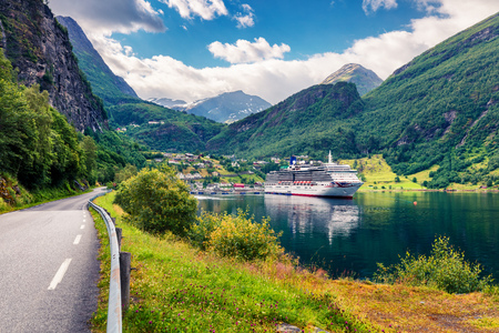 Sunny summer scene of Geiranger port, western Norway. Splendid view of Sunnylvsfjorden fjord. Traveling concept background.