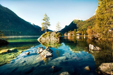 Sunny autumn scene of Hintersee lake. Colorful morning view of Bavarian Alps on the Austrian border, Germany, Europe.