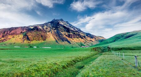 Typical icelandic landscape near Skogafoss waterfall in south Iceland, Europe. Green summer scene of North countryside. Beauty of nature concept background.