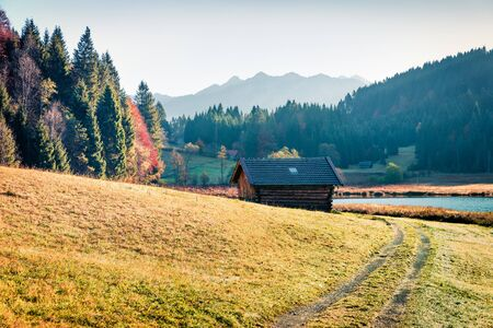 Sunny morning scene of Wagenbruchsee lake with Kaltwasserkar Spitze mountain range on background. Beautifel autumn view of Bavarian Alps, Germany, Europe.