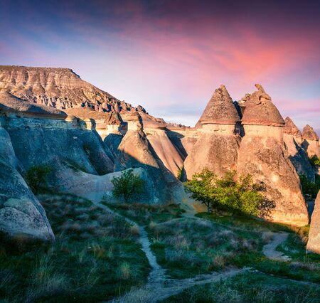 Gorgeous fungous forms of sandstone in the canyon near Cavusin village, Cappadocia, Nevsehir Province in the Central Anatolia Region of Turkey, Asia. Beauty of nature concept background. Zdjęcie Seryjne