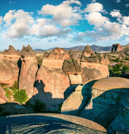 Exciting fungous forms of sandstone in the canyon near Cavusin village, Cappadocia, Nevsehir Province in the Central Anatolia Region of Turkey, Asia. Beauty of nature concept background