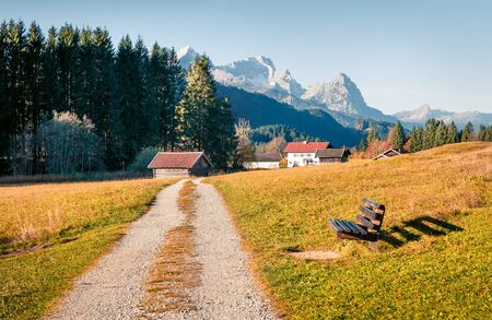 Sunny morning scene of Zugspitze mountain range, Wagenbruchsee (Geroldsee) lake lacation. Beautiful autumn view of Bavarian Alps, Germany, Europe. Beauty of nature concept background. 写真素材