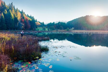 Misty morning scene of Wagenbruchsee lake. Photographer takes pictures of beautifel autumn view of Bavarian Alps, Germany, Europe. Traveling concept background.