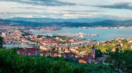 Aerial spring view of port of La Spezia city. Sunny morning scene of Mediterranean sea, Liguria, Italy, Europe. Magnificent Mediterranean landscape. Artistic style post processed photo.