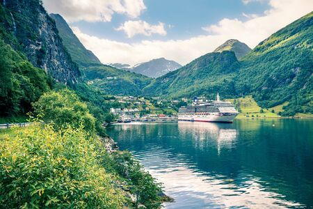 Splendid summer scene of Geiranger port, western Norway. Marvelous view of Sunnylvsfjorden fjord. Traveling concept background. Artistic style post processed photo. Zdjęcie Seryjne